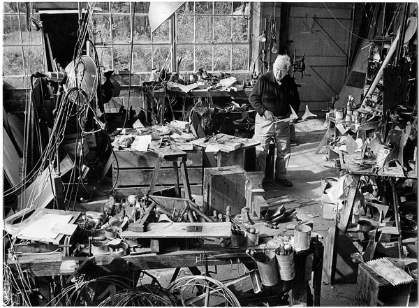 Alexander Calder at work in his studio.